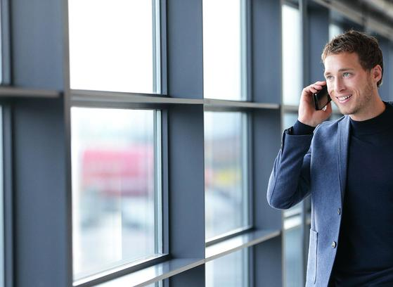 Man taking call on mobile indoors