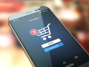 46105618 - online shopping concept. mobile phone or smartphone with cart on the screen. 3d